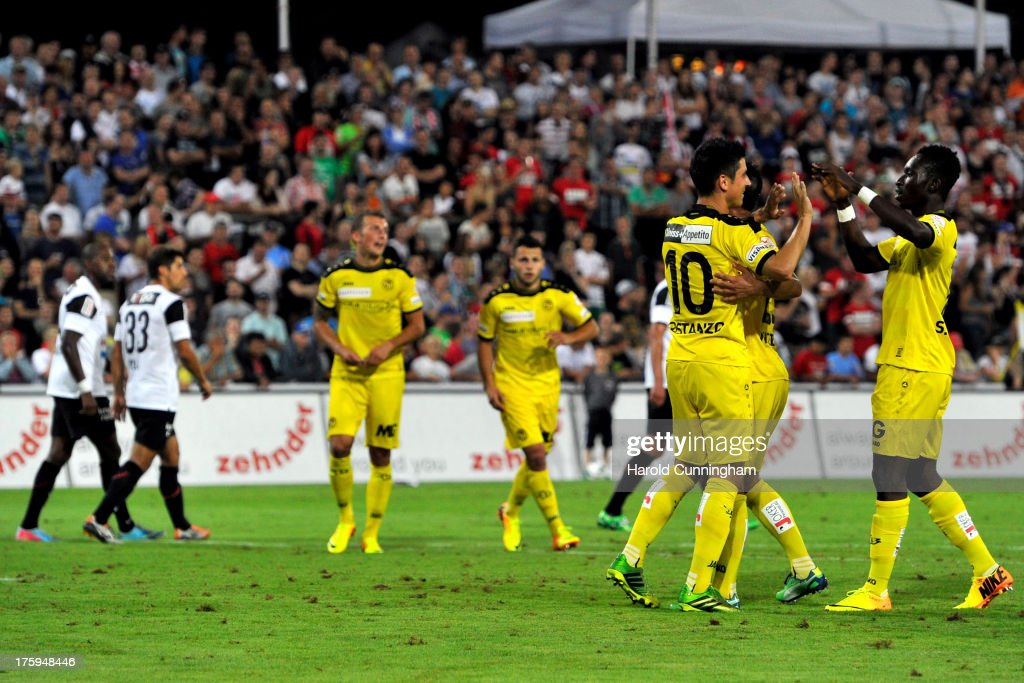 Moreno Costanzo (2nd R) celebrates scoring the fourth goal for BSC Young Boys by penalty during the Swiss Super League match between FC Aarau v BSC Young Boys at Brugglifeld on August 10, 2013 in Aarau, Switzerland.