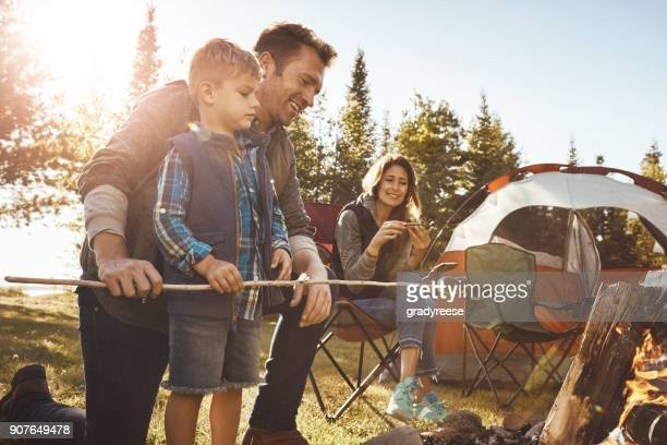 s'mores means some more especially when camping - camping stock photos and pictures