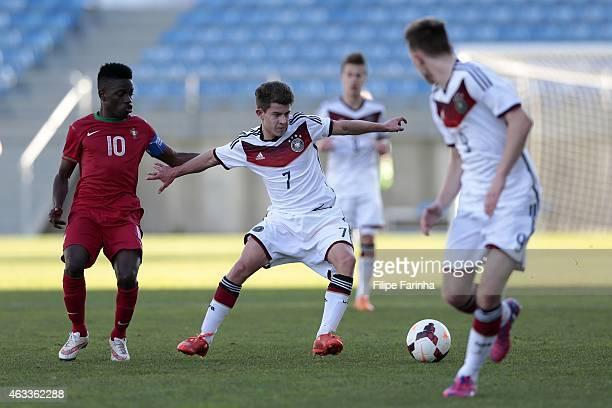 Moreto Cassama of Portugal challenges Mats Kohlert of Germany during the U17 Algarve Cup match between Germany and Portugal at Algarve Stadium on...
