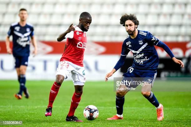 Moreto CASSAMA of Reims and Yacine ADLI of Bordeaux during the Ligue 1 match between Reims and Girondins Bordeaux at Stade Auguste Delaune on May 23,...