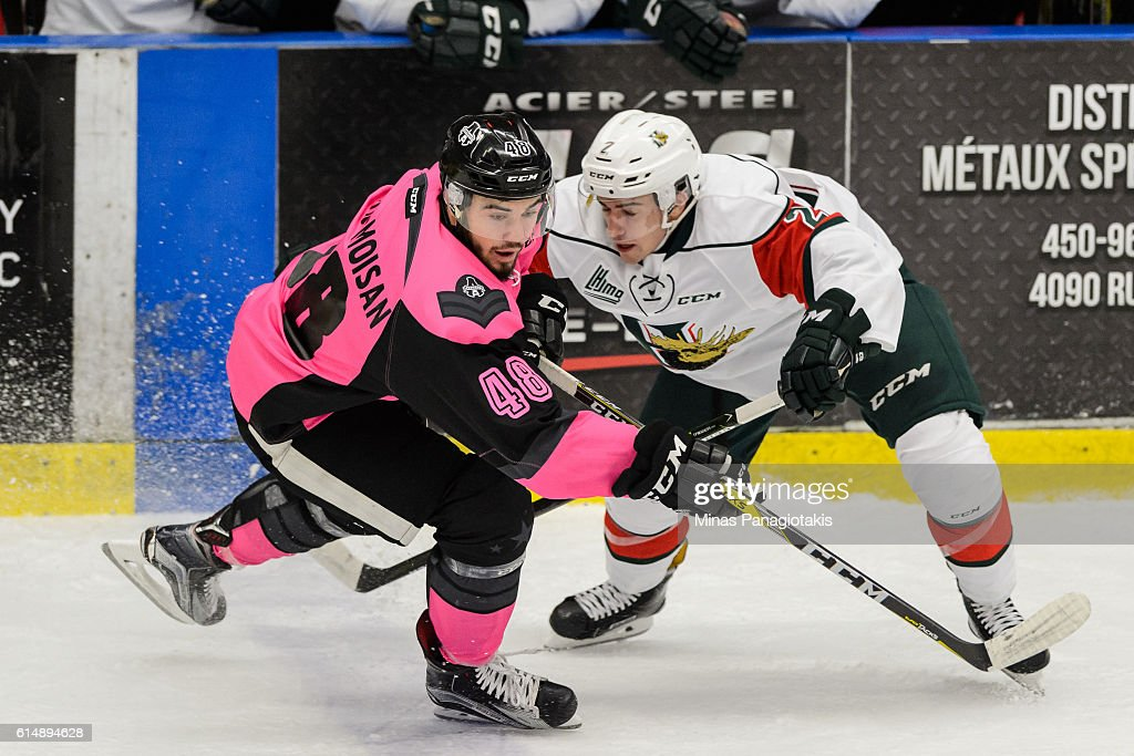 Morgan Adams-Moisan #48 of the Blainville-Boisbriand Armada skates against Cooper Jones #2 of the Halifax Mooseheads during the QMJHL game at the Centre d'Excellence Sports Rousseau on October 15, 2016 in Boisbriand, Quebec, Canada.