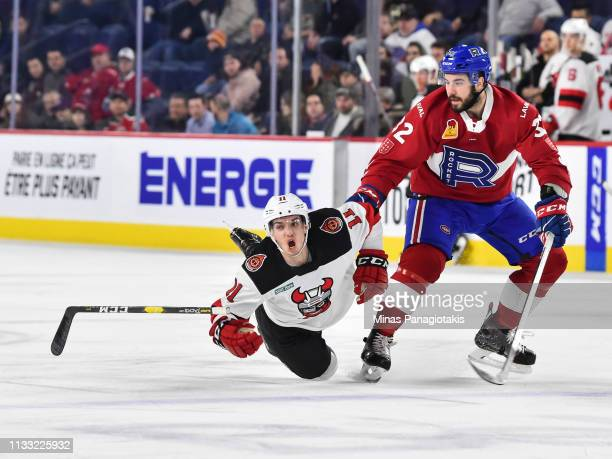 Morgan AdamsMoisan of the Laval Rocket takes down Brett Seney of the Binghamton Devils during the AHL game at Place Bell on March 27 2019 in Laval...