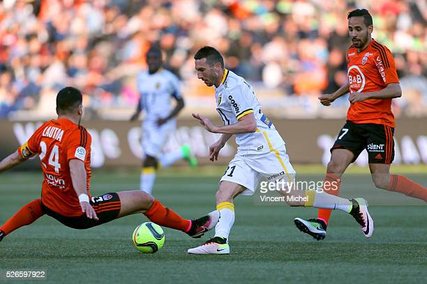 Morgan Amalfitano of Lille and Wesley Lautoa and Walid Mesloub of Lorient during the French Ligue 1 match between Fc Lorient and Lille OSC at Stade...