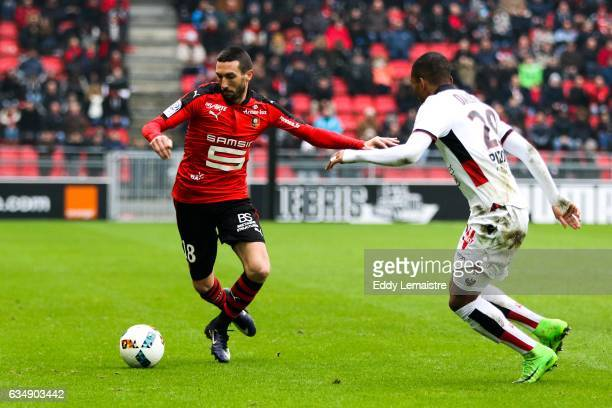 Morgan Amalfitano of Rennes and Dalbert of Nice during the Ligue 1 match between Stade Rennais and OGC Nice at Roazhon Park on February 12 2017 in...
