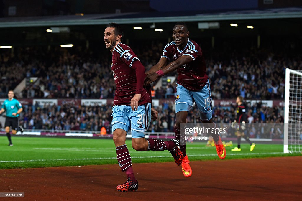 Morgan Amalfitano of West Ham celebrates with teammate Diafra Sakho of West Ham after scoring his team's third goal during the Barclays Premier League match between West Ham United and Liverpool at Boleyn Ground on September 20, 2014 in London, England.