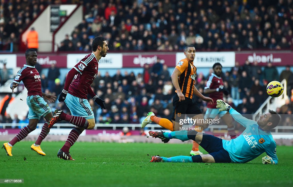 Morgan Amalfitano of West Ham United (2L) beats goalkeeper Allan McGregor of Hull City to score their second goal during the Barclays Premier League match between West Ham United and Hull City at Boleyn Ground on January 18, 2015 in London, England.