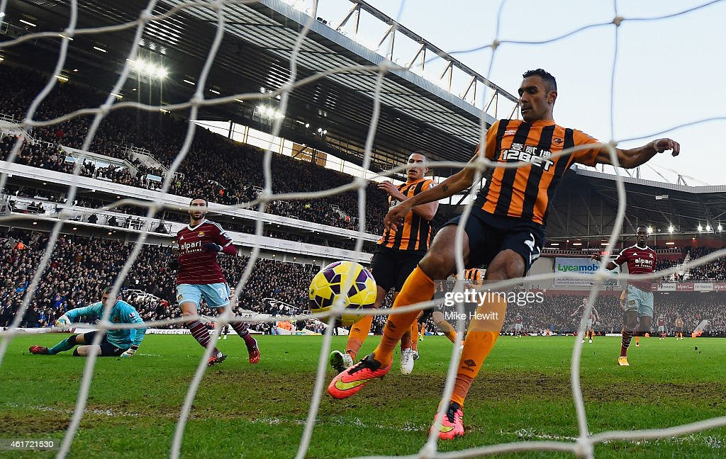 Morgan Amalfitano of West Ham United (2L) beats goalkeeper Allan McGregor (L) and defender Ahmed Elmohamady of Hull City (R) to score their second goal during the Barclays Premier League match between West Ham United and Hull City at Boleyn Ground on January 18, 2015 in London, England.