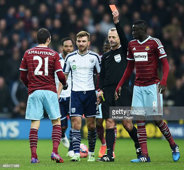 Morgan Amalfitano of West Ham United is shown a red card by referee Martin Atkinson and is sent off during the FA Cup Fifth Round match between West...