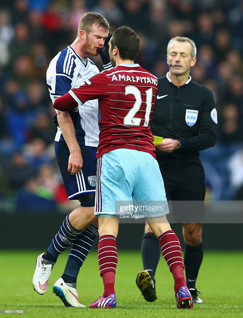 Morgan Amalfitano of West Ham United (21) pushes Chris Brunt of West Bromwich Albion in the face and is then sent off by referee Martin Atkinson (R) during the FA Cup Fifth Round match between West Bromwich Albion and West Ham United at The Hawthorns on February 14, 2015 in West Bromwich, England.