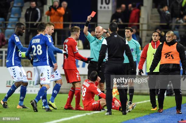 Morgan Amalfitano receives a red card by Tony Chapron during the Ligue 1 match between Strasbourg and Rennes at Stade de la Meinau on November 18...