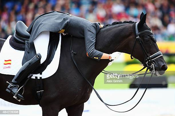 Morgan Barbancon Mestre of Spain reacts on her horse Painted Black during the Dressage Grand Prix Freestyle individual competition on Day 5 of the...