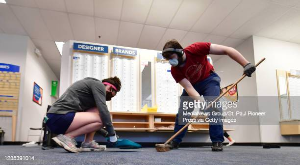 "Morgan Bartlett and Collin Smith both from St. Paul sweep up the last remnants of broken glass and debris in the America""u2019s Best Eye Glass shot..."