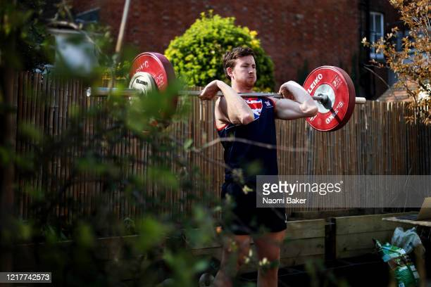 Morgan Bolding of Great Britain does a weights session in his garden of Great Britain does a weights session in his garden on March 27 2020 in...