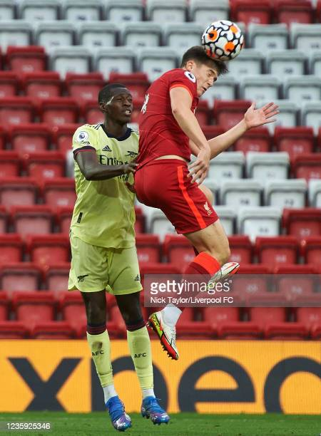 Morgan Boyes of Liverpool and Mazeed Ogungbo of Arsenal in action during the PL2 game at Anfield on October 16, 2021 in Liverpool, England.
