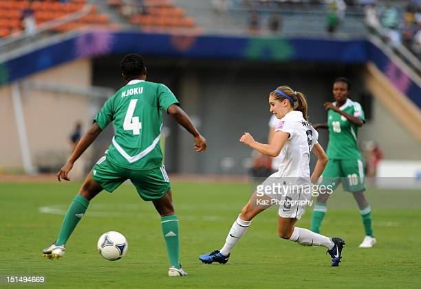 Morgan Brian of USA and Ugo Njoku of Nigeria compete for the ball during the FIFA U20 Women's World Cup Japan 2012 Semi Final match between Nigeria...