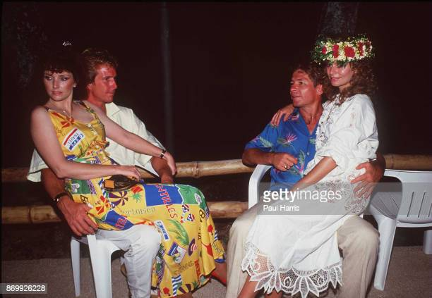 Morgan Brittany John Denver and Australian actress Cassandra Delaney who he married in 1988 rest at the end of a day filming ' Bob Hopes Tropical...