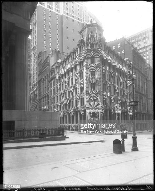 Morgan Building corner of Wall Street and Nassau Street decorated with flagsNew York New York late 1900s