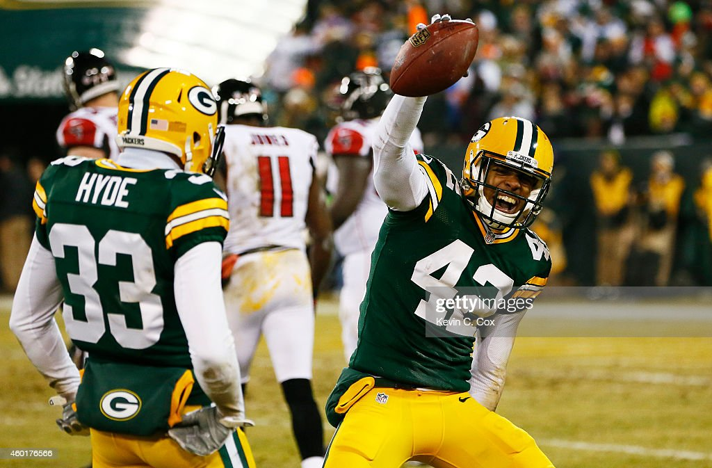 Morgan Burnett #42 celebrates his interception with Micah Hyde #33 of the Green Bay Packers in the second quarter against the Atlanta Falcons at Lambeau Field on December 8, 2014 in Green Bay, Wisconsin.