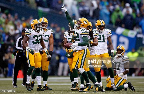 Morgan Burnett of the Green Bay Packers celebrates after making an interception during the fourth quarter of the 2015 NFC Championship game against...