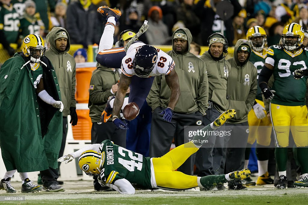 Morgan Burnett #42 of the Green Bay Packers hits Martellus Bennett #83 of the Chicago Bears in the second quarter during the NFL game at Lambeau Field on November 09, 2014 in Green Bay, Wisconsin.