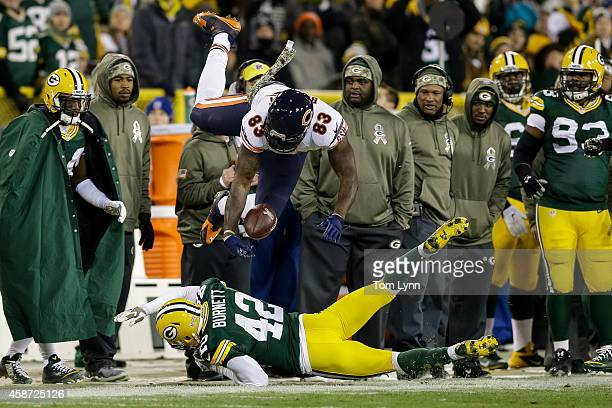 Morgan Burnett of the Green Bay Packers hits Martellus Bennett of the Chicago Bears in the second quarter during the NFL game at Lambeau Field on...