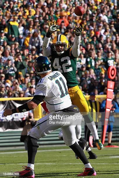 Morgan Burnett of the Green Bay Packers looks to block a pass against Blaine Gabbert of the Jacksonville Jaguars at Lambeau Field on October 28 2012...