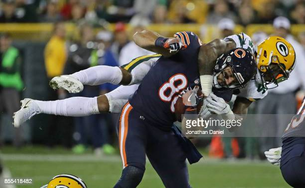Morgan Burnett of the Green Bay Packers tackles Zach Miller of the Chicago Bears at Lambeau Field on September 28 2017 in Green Bay Wisconsin