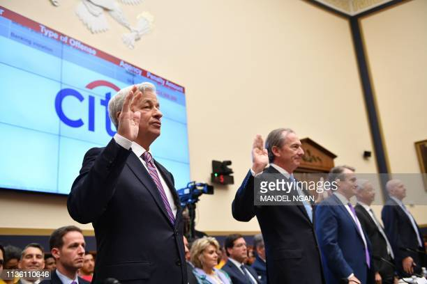 JP Morgan Chase Co Chairman Chief Executive Officer James Dimon and others are sworn in before they testify before the House Financial Services...