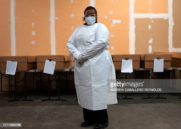 Morgan Dean-McMillan transporter, poses for a picture in front of a row of cardboard caskets, at Maryland Cremation services in Millersville,...