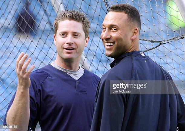 Morgan Ensberg and Derek Jeter of the New York Yankees have a laugh during batting practice before playing the Cleveland Indians on May 7 2008 at...