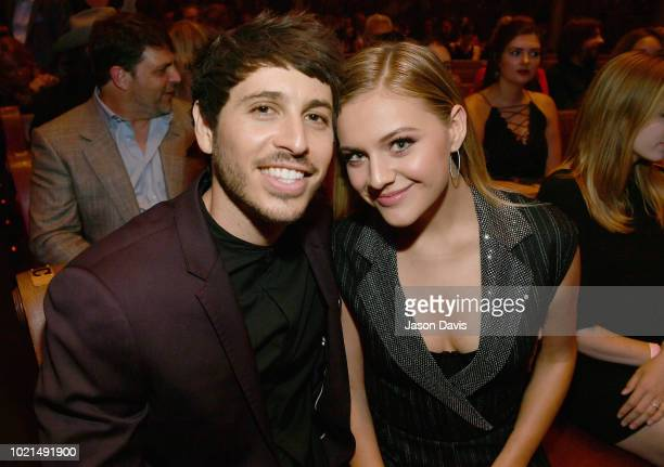 Morgan Evans and Kelsea Ballerini take photos during the 12th Annual ACM Honors at Ryman Auditorium on August 22 2018 in Nashville Tennessee