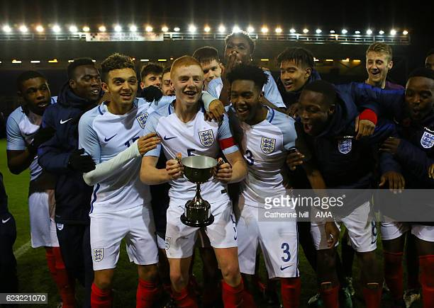 Morgan Feeney of England U18 and his team mates celebrate with a trophy after the U18 International Friendly match between England and France at...