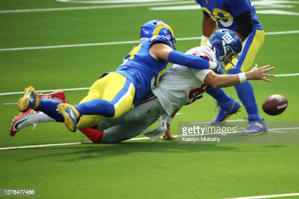 Morgan Fox of the Los Angeles Rams sacks Daniel Jones of the New York Giants during the first half at SoFi Stadium on October 04, 2020 in Inglewood,...