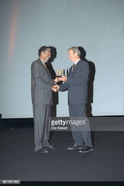 Morgan Freeman presents Clint Eastwood with a prize in recognition of his exceptional career both as an actor and as a film director
