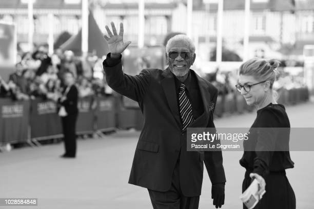 Morgan Freeman waves as he arrives to attend the award ceremony for his lifetime achievment at the 44th Deauville American Film Festival on September...