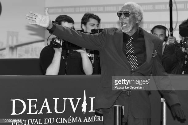 Morgan Freeman waves to the crowd as he arrives to attend the award ceremony for his lifetime achievment at the 44th Deauville American Film Festival...