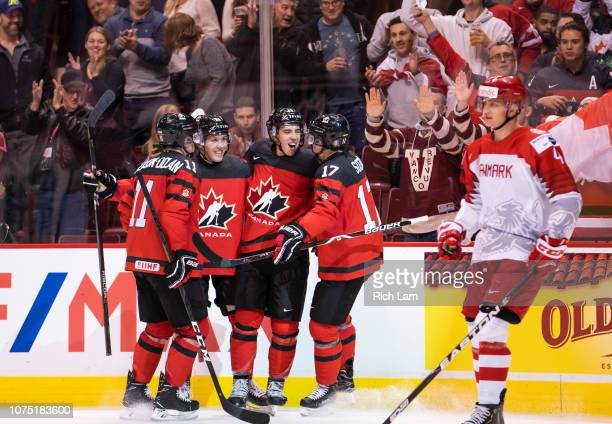 Morgan Frost of Canada celebrates with teammates Jaret AndersonDolan Ty Smith and Nick Suzuki after scoring his third goal of the game as Lasse...