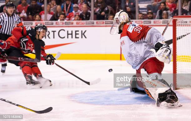 Morgan Frost of Canada shoots the puck past goalie Mads Soegaard of Denmark for his third goal of the game in Group A hockey action of the 2019 IIHF...