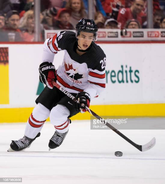 Morgan Frost of Canada skates with the puck in Group A hockey action of the 2019 IIHF World Junior Championship action against Switzerland on...