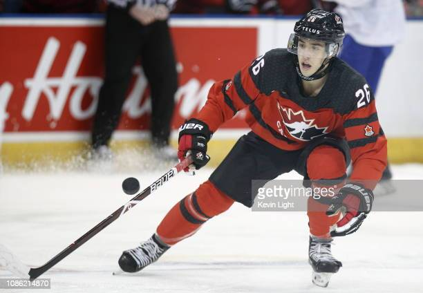 Morgan Frost of Team Canada attempt to gain control of a bouncing puck versus Team Slovakia at the IIHF World Junior Championships at the SaveonFoods...