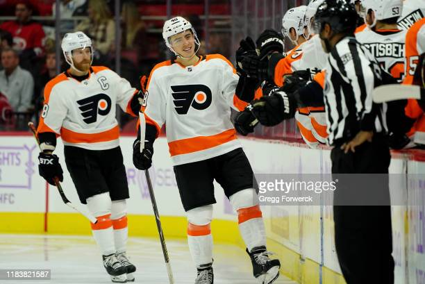 Morgan Frost of the Philadelphia Flyers celebrates with the bench after scoring a goal during an NHL game against the Carolina Hurricanes on November...