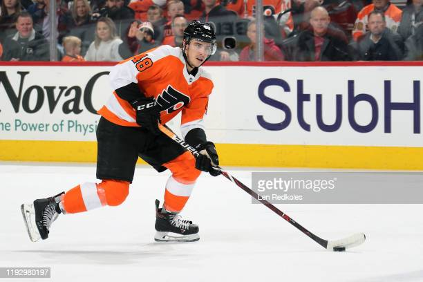 Morgan Frost of the Philadelphia Flyers skates the puck against the Toronto Maple Leafs on December 3 2019 at the Wells Fargo Center in Philadelphia...