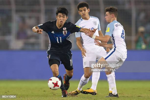 Morgan Gibbs White and George McEachran of England battle for the ball with Taisei Miyashiro of Japan during the FIFA U-17 World Cup India 2017 Round...