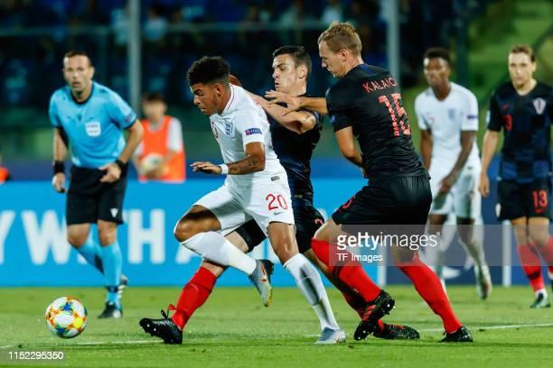 Morgan GibbsWhite of England Filip Uremovic of Croatia and Branimir Kalaica of Croatia battle for the ball during the 2019 UEFA U21 Group C match...