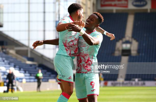 Morgan GibbsWhite of Swansea City celebrates with Jamal Lowe after scoring the opening goal during the Sky Bet Championship match between Preston...