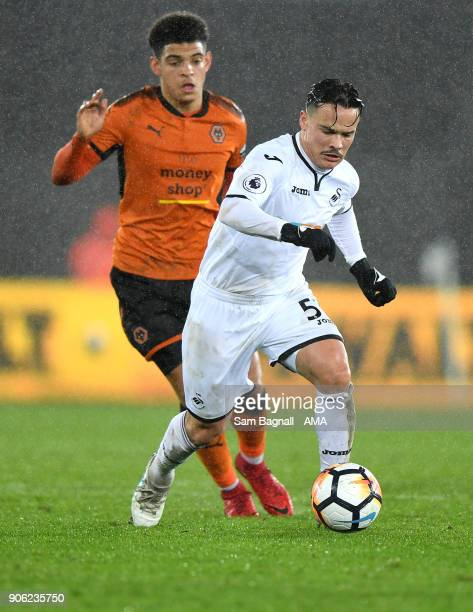 Morgan GibbsWhite of Wolverhampton Wanderers and Roque Mesa of Swansea City during The Emirates FA Cup Third Round Replay between Swansea City and...