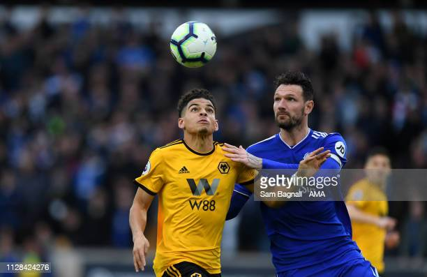 Morgan Gibbs-White of Wolverhampton Wanderers and Sean Morrison of Cardiff City during the Premier League match between Wolverhampton Wanderers and...