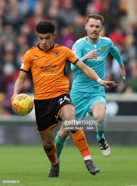 Morgan GibbsWhite of Wolverhampton Wanderers and Tom Naylor of Burton Albion during the Sky Bet Championship match between Wolverhampton Wanderers...