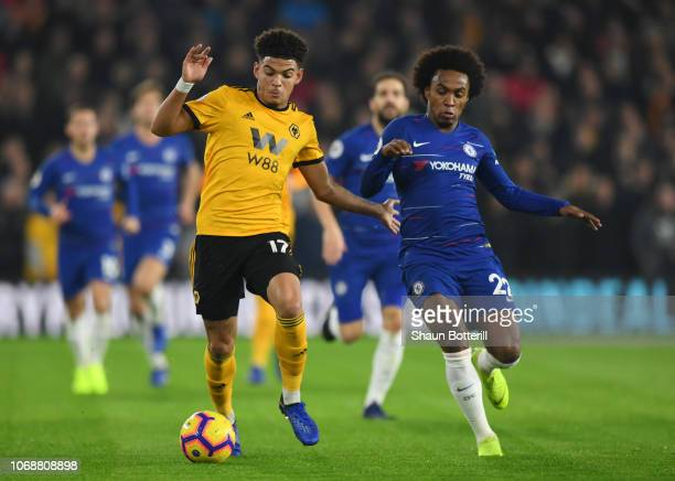 Morgan GibbsWhite of Wolverhampton Wanderers battles for possession with Willian of Chelsea during the Premier League match between Wolverhampton...