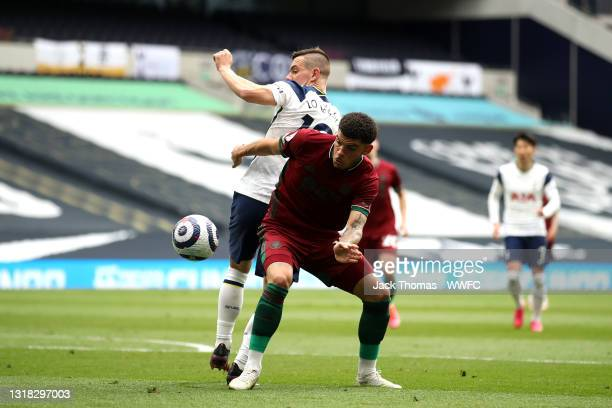 Morgan Gibbs-White of Wolverhampton Wanderers battles for possession with Giovani Lo Celso of Tottenham Hotspur during the Premier League match...